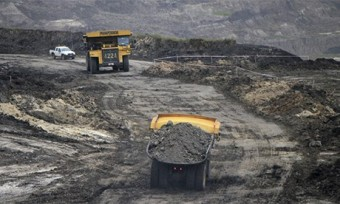 MDG : KPC coal mining company truck in East Kutai, Kalimantan, Borneo
